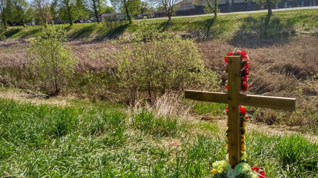 A cross marks the spot where Tammy Keeash is said to have been with friends the night she died last month. Her body was found just below in the Neebing McIntyre floodway where police say the 17-year-old drowned.