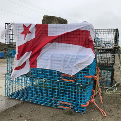 Mi'kmaw flag over lobster cages