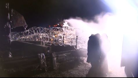 Police in North Dakota unleash a water cannon against water protectors on Oct. 20.