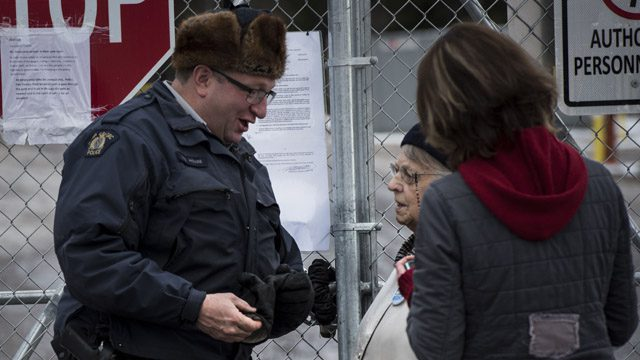 Dorothy Michelin speaking to an RCMP officer Saturday. Submitted photo.