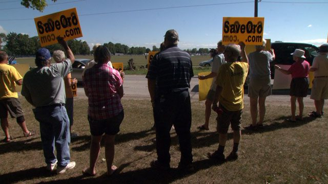 Save Oro protesters Friday greeting people as they arrived to WayHome.