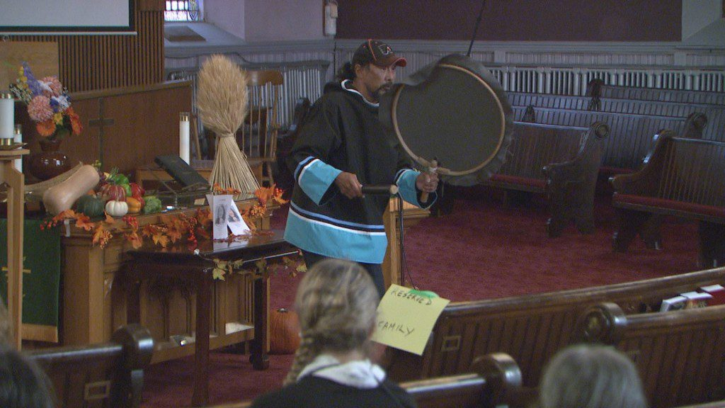 July Papasie drums during Annie Pootoogook's memorial service in Ottawa on Thursday, Oct. 13, 2016.