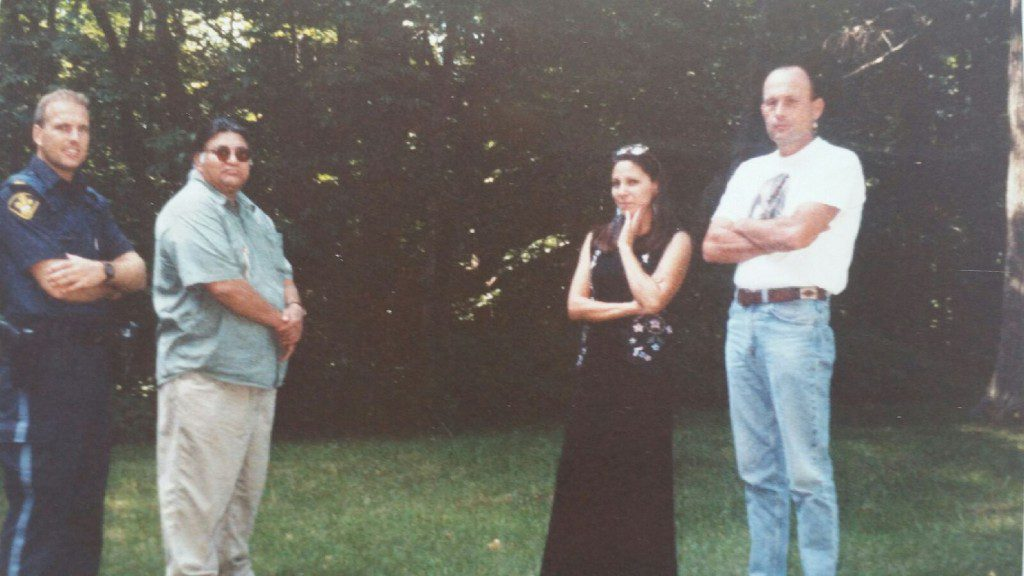 Sgt. Chris Gheysen, left, with Dan Smoke, Mag Cywink and her husband Tom Wopperer, far right, in this undated photo. Submitted.