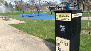 A needle drop box next to a children's playground in London, Ontario's Ivey Park. Kenneth Jackson/APTN photo