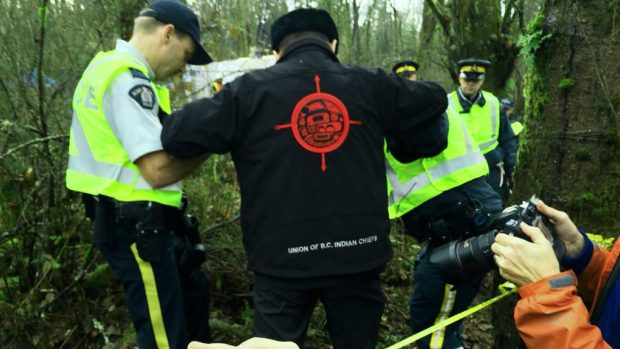 Gand Chief Stewart Phillip arrested on Burnaby Mountain on Nov. 27, 2014, during protest against Trans Mountain pipeline. Farrah Merali/Twitter